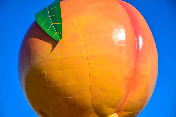 Peachoid Peach in Gaffney South Carolina SC Peachoid Peach Water Tower in Gaffney South Carolina SC along Interstate 85. spartanburg stock pictures, royalty-free photos & images