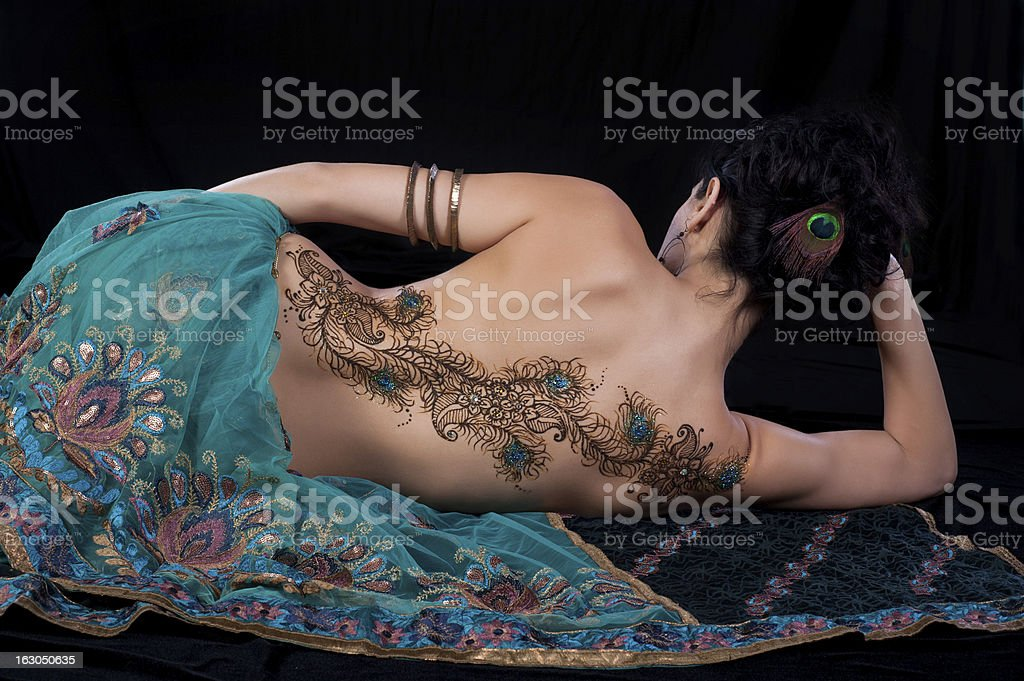Peacock Feather Henna Design on a Woman's Back stock photo