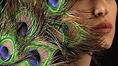 Peacock feather and beutiful lips