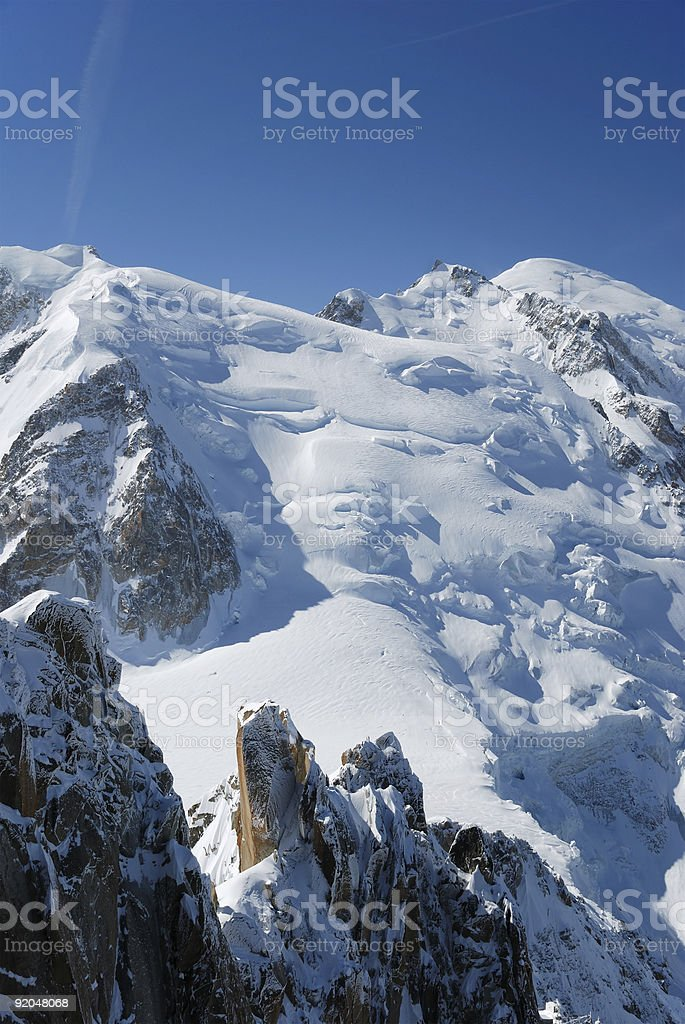 Peak and glacier under blue sky, the Alps royalty-free stock photo