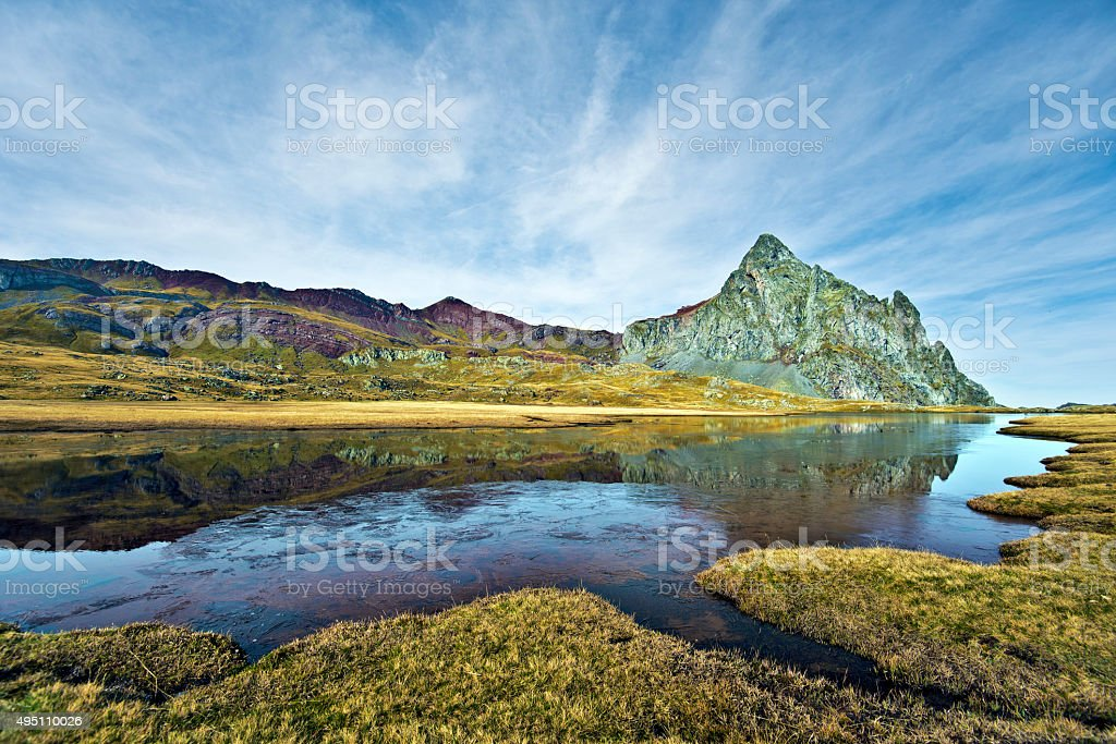 Peak and Vertice of Anayet reflecting in Lake Surface stock photo