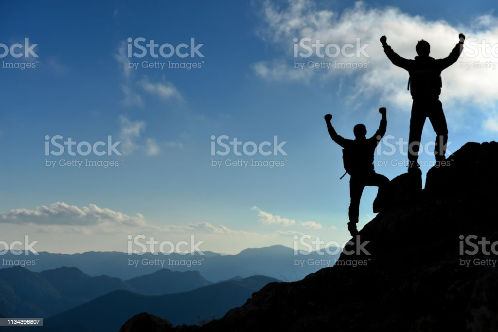 Peak triumph and success for climbers stock photo