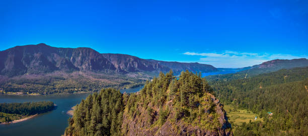 Peaking over the top of Beacon Rock on a sunny summer morning in the Columbia River Gorge-1 stock photo