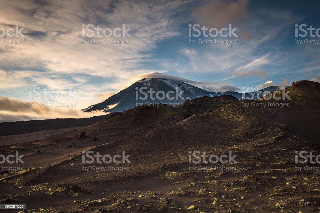 Peaks and slopes of Tolbachik Volcano during sunset royaltyfri bildbanksbilder