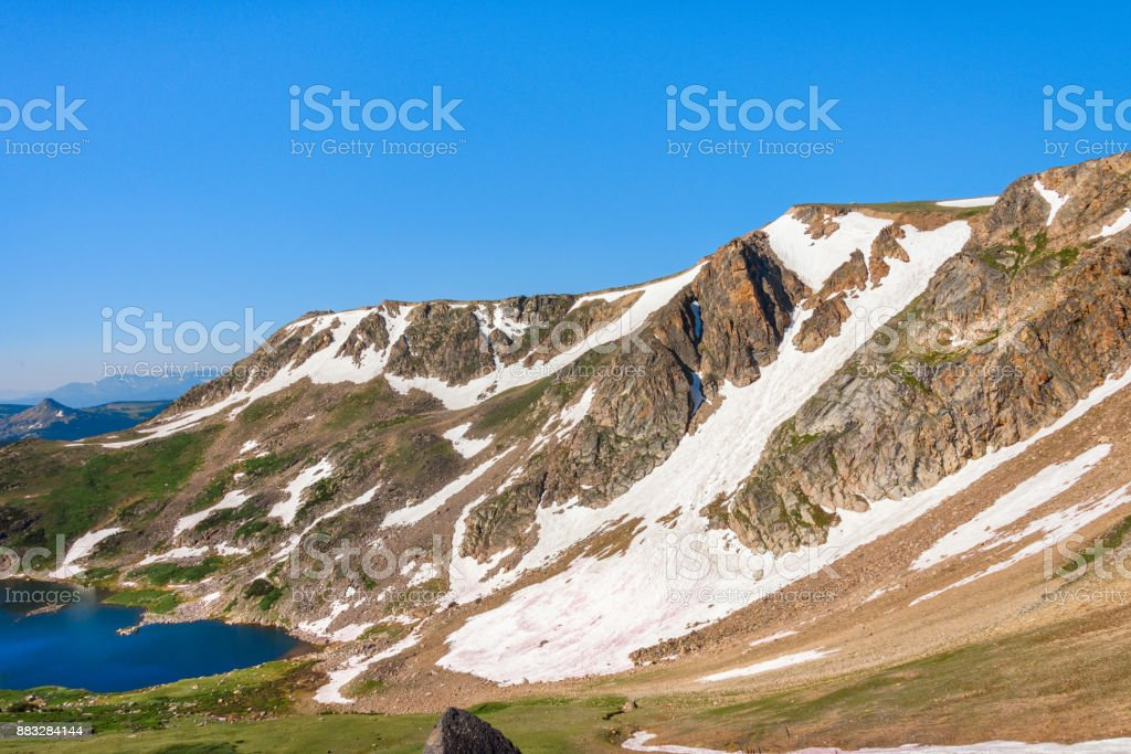 Peaks of Beartooth Mountains, Wyoming, USA. Gardner Lake of Beartooth Pass. stock photo