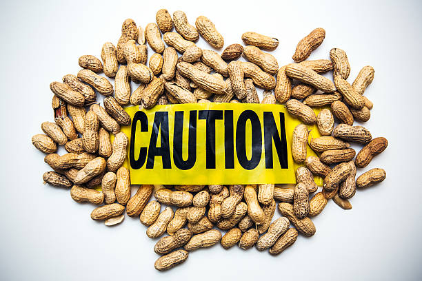 peanut allergy caution - food allergies stock photos and pictures