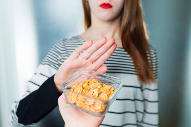 peanut allergy concept - food intolerance - food allergies stock photos and pictures