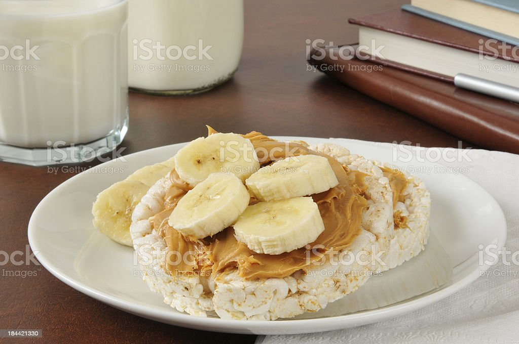 Peanut butter and banana on a rice cake stock photo