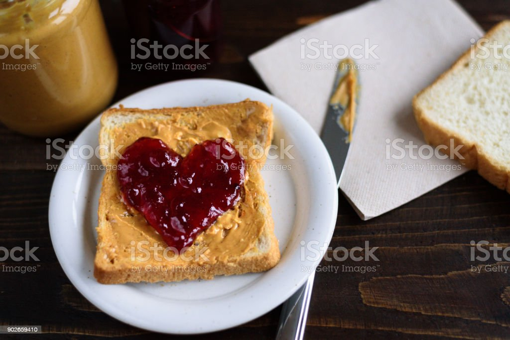 Peanut butter and heart shaped jelly sandwich stock photo