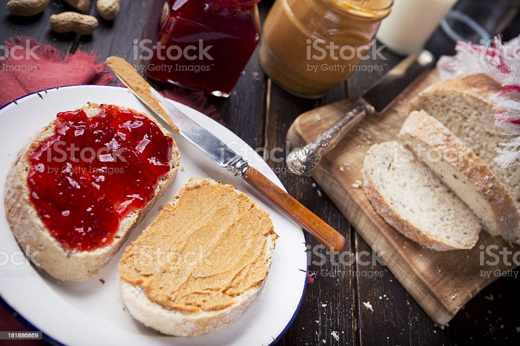 Peanut butter and jelly sandwich on a rustic table royalty-free stock photo