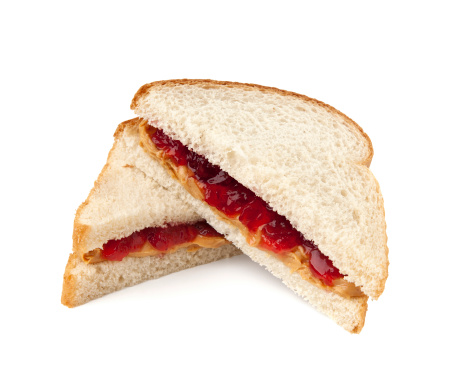 Peanut butter and jelly sandwich with clipping path on white background.  Please see my portfolio for other food and drink images.