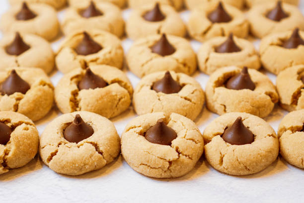 Peanut butter blossom cookies Peanut butter blossom cookies on a flat surface blossom stock pictures, royalty-free photos & images
