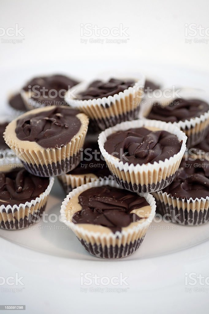 Peanut Butter Cups on White Plate. stock photo