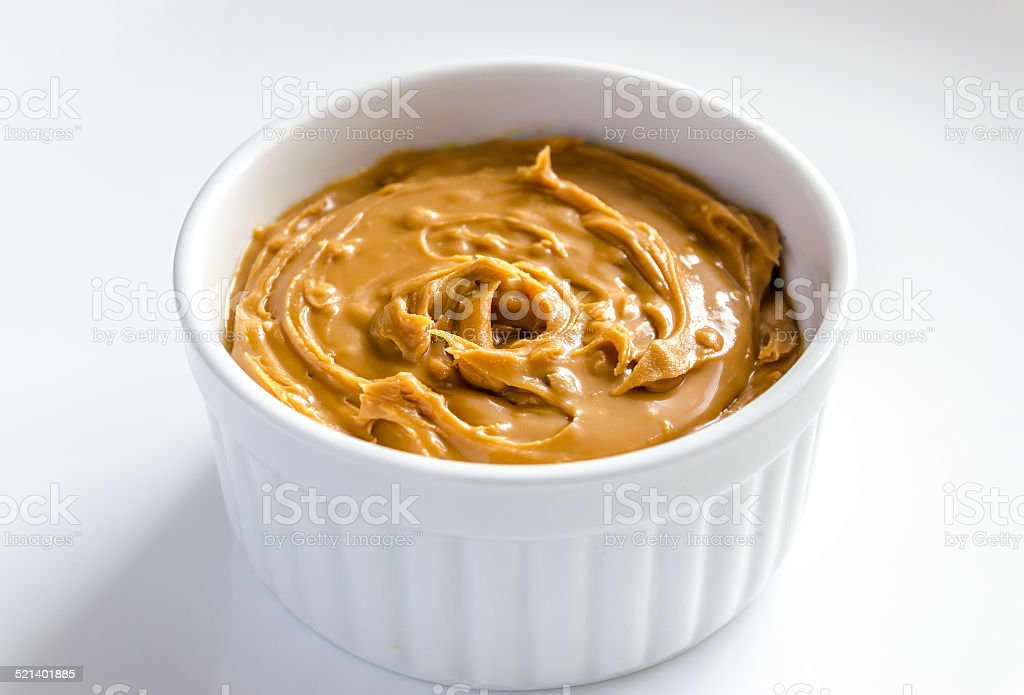 Peanut butter in a bowl stock photo