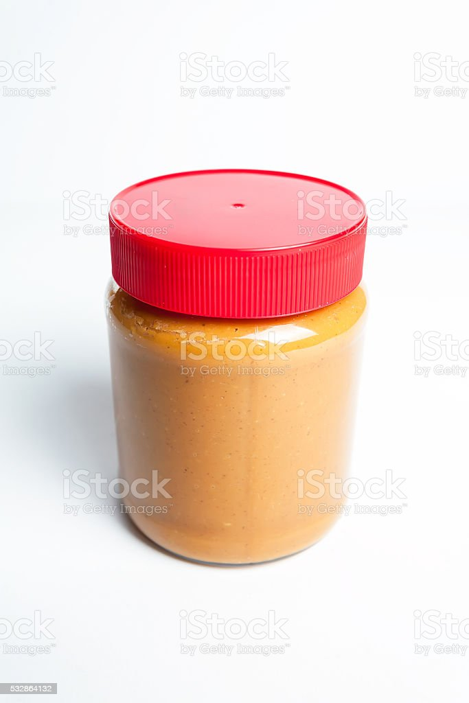 Peanut butter in a jar with red cap isolated white. stock photo