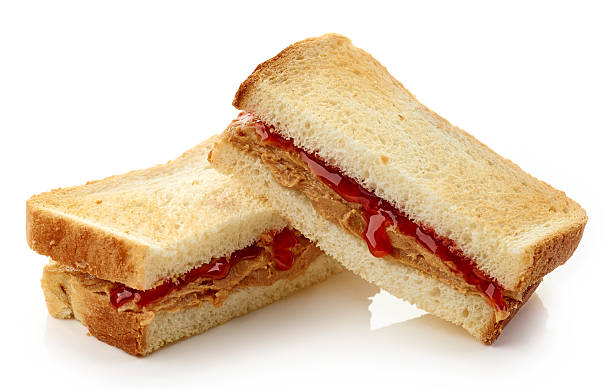 Peanut butter jelly sandwich Peanut butter and strawberry jelly sandwich isolated on white background gelatin stock pictures, royalty-free photos & images