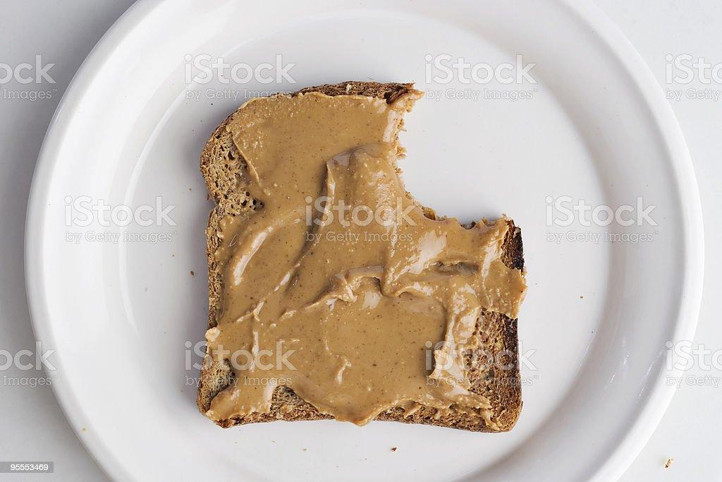 Peanut butter on bread stock photo