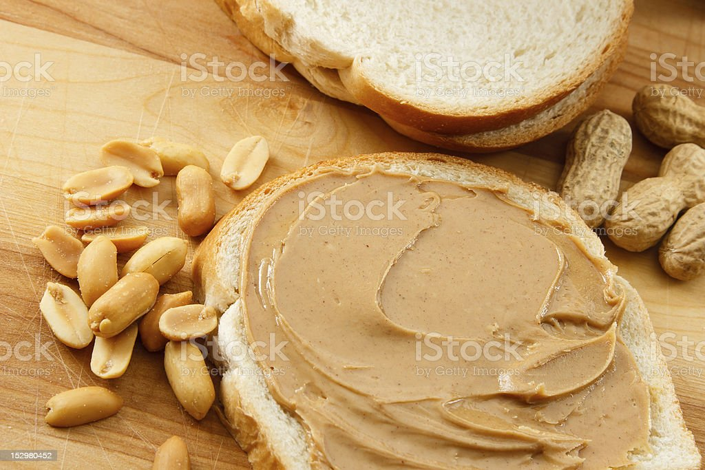 Peanut Butter on Bread with Peanuts stock photo