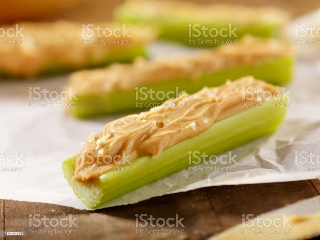 Peanut Butter on Sticks of Celery stock photo
