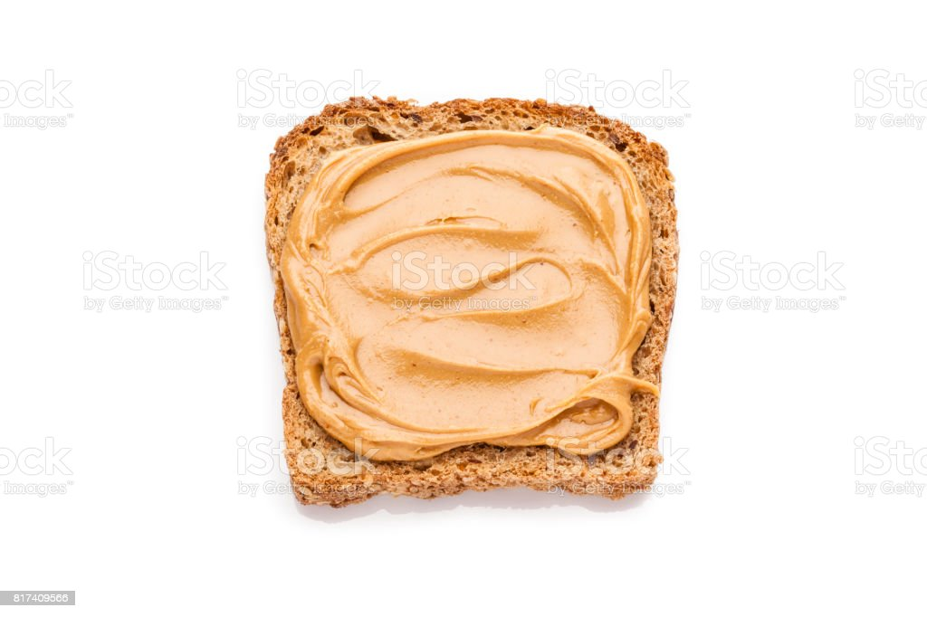 Peanut butter on toast isolated on white background stock photo