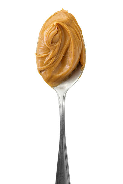 peanut butter - spoon stock photos and pictures