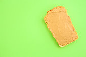 istock peanut butter sandwich (tasty snack, bread or toast buttered with nut butter) menu concept. food background. copy space. Top viev 1177697217