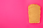 istock peanut butter sandwich (tasty snack, bread or toast buttered with nut butter) menu concept. food background. copy space. Top viev 1177697223