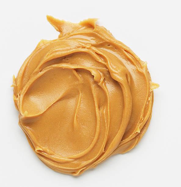 peanut butter spread - pindakaas stockfoto's en -beelden