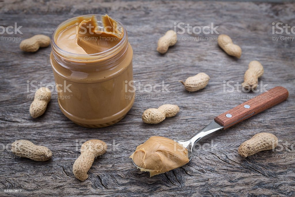 Peanut cream in a jar. Dietary foods for the heart. stock photo