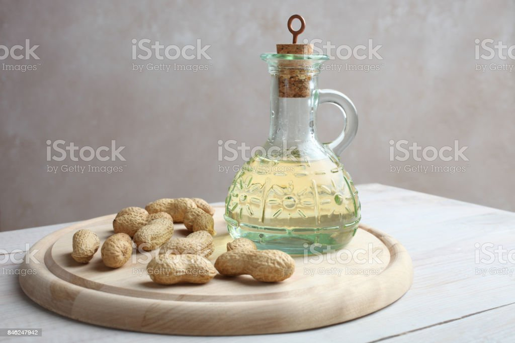 Peanut in a shell with an oil bottle stock photo