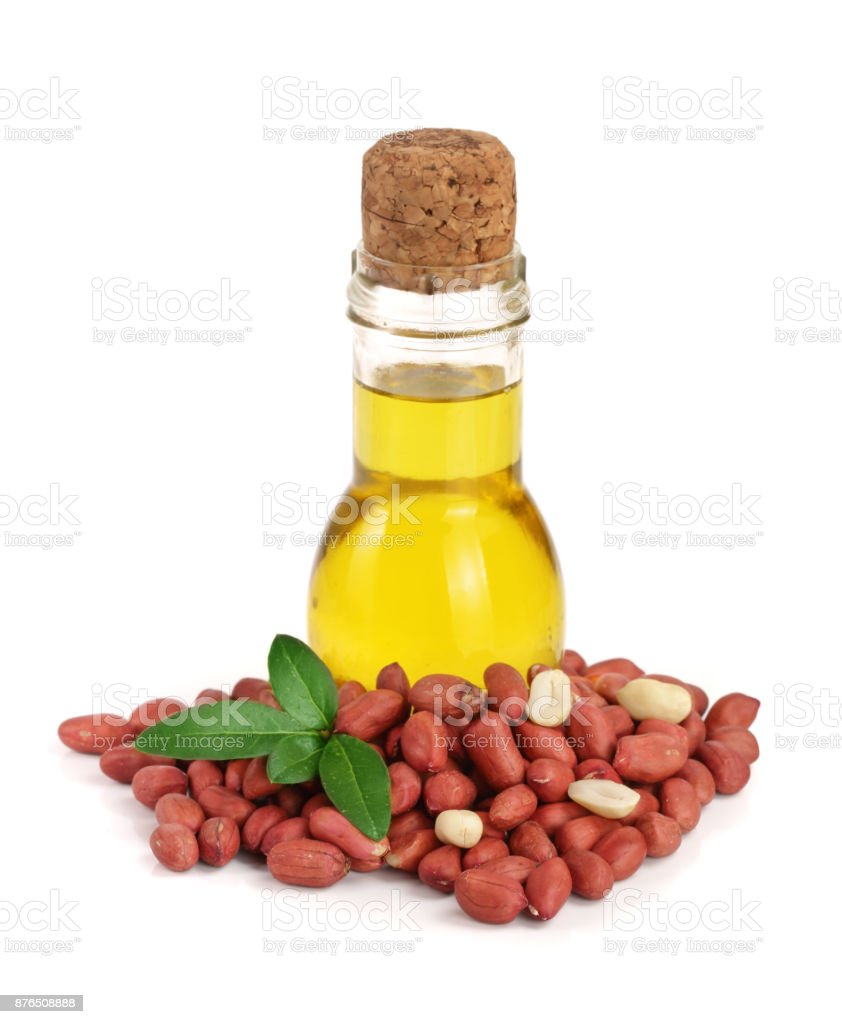 peanut oil in a glass bottle with peanuts stock photo