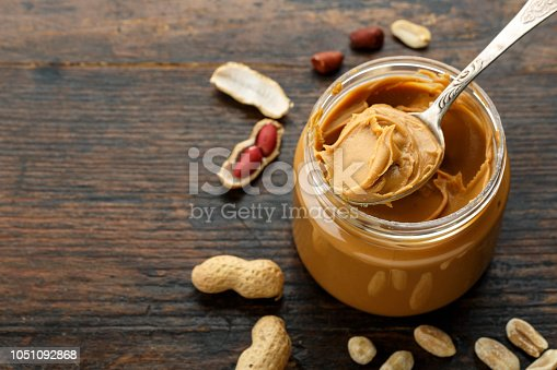 istock peanut paste in an open jar and peanuts 1051092868