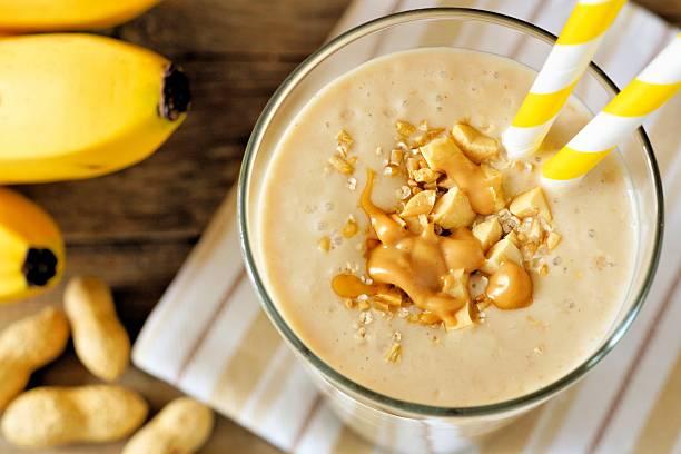 peanut-butter banana oat smoothie close up, downward view - peanutbutter bildbanksfoton och bilder