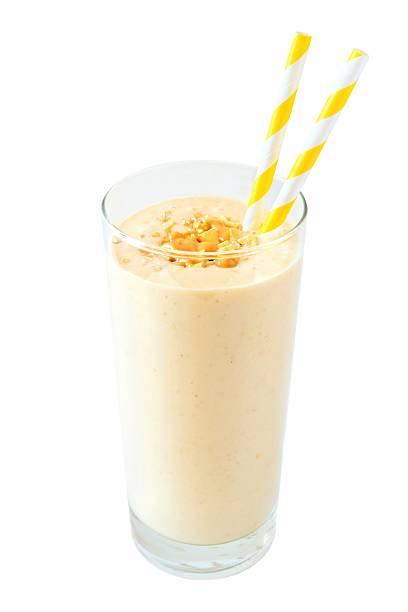 peanut-butter banana oat smoothie with straws isolated on white - peanutbutter bildbanksfoton och bilder