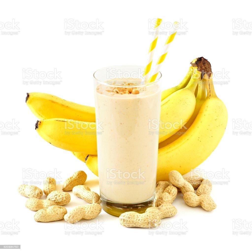Smoothie banane beurre de cacahuète et des produits présents sur blanc - Photo