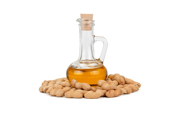 peanuts and oil in bottle stock photo