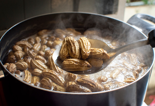 Boiled peanut,Peanuts boiled in ladle with boiling peanuts as a backdrop.