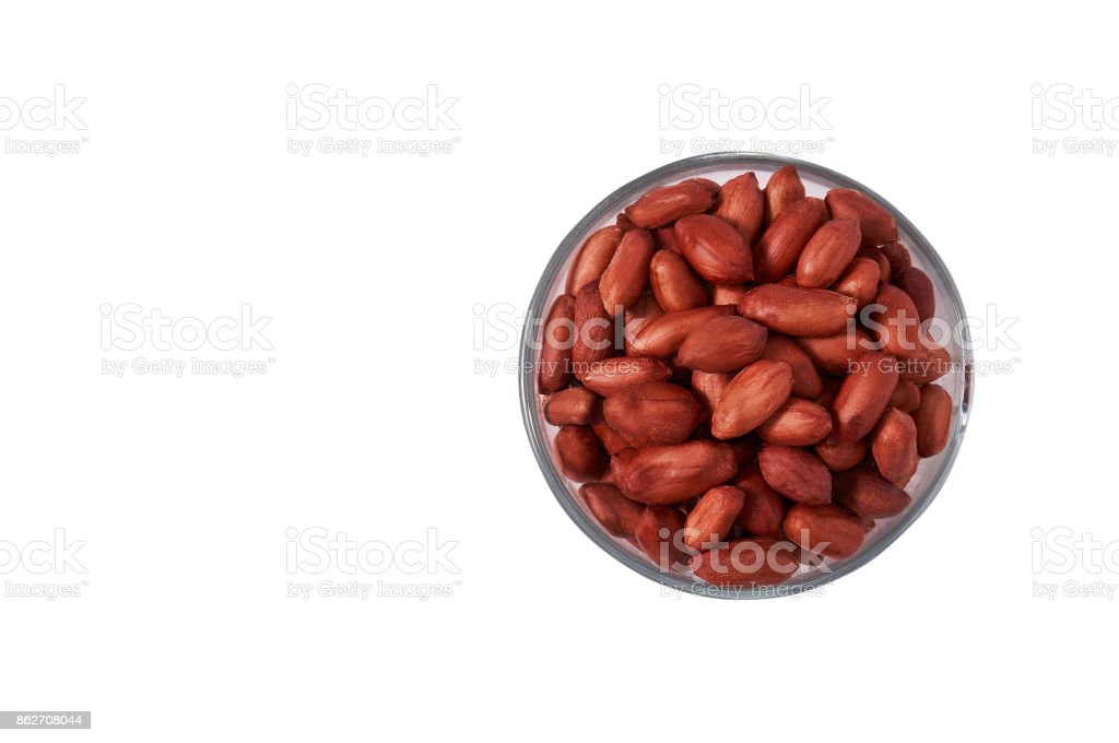 Peanuts in a glass bowl on a white background isolate. stock photo