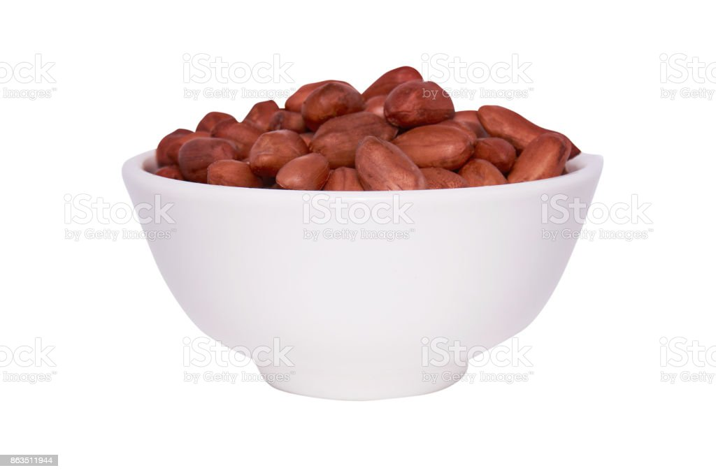 Peanuts in a white bowl on a white background. Isolate. stock photo