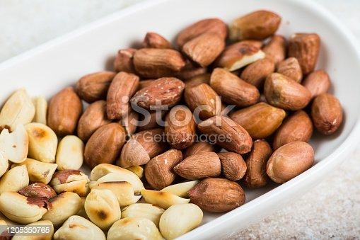 Peanuts in a white cup an old wooden floor. ramadan food. healthy nutrition. healthy food. vegetarian snack.