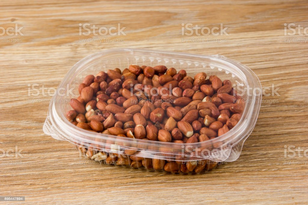 Peanuts in plastic packaging. stock photo