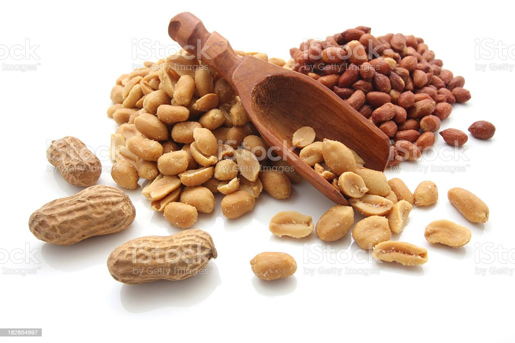 Peanuts, in shell and out, with scoop on a white background stock photo