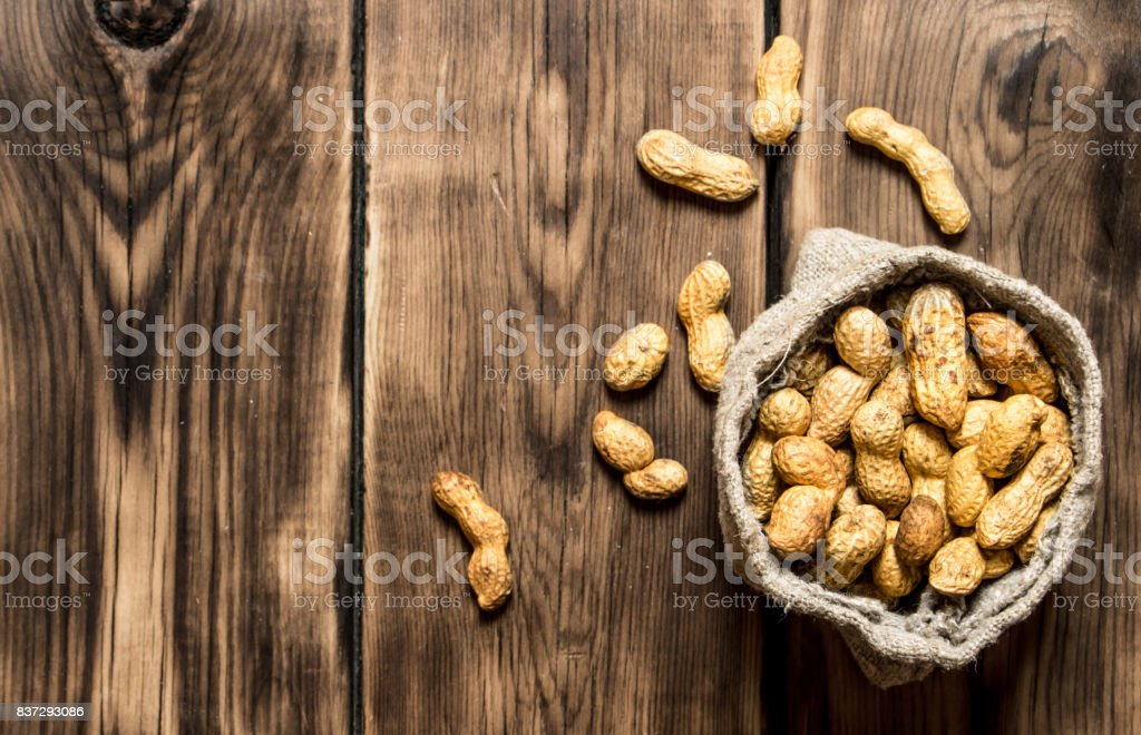 Peanuts in the old bag. stock photo