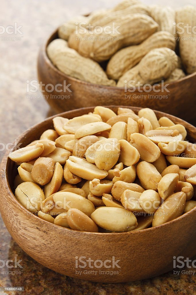 Peanuts in wood bowls royalty-free stock photo