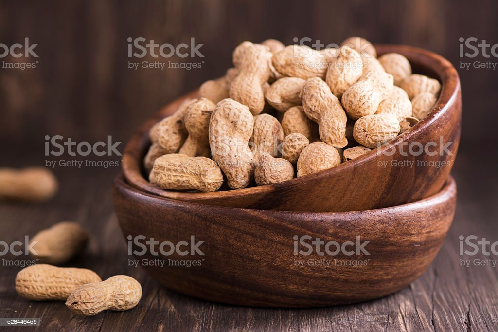 Peanuts in wooden bowls stock photo
