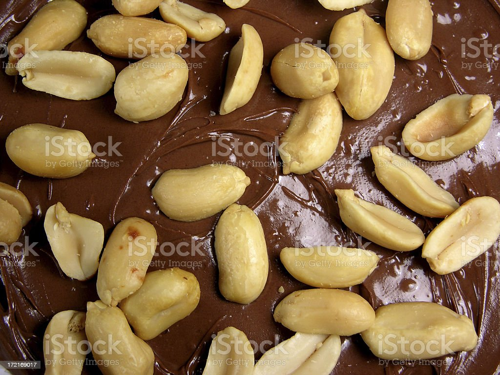 Peanuts on top of chocolate royalty-free stock photo