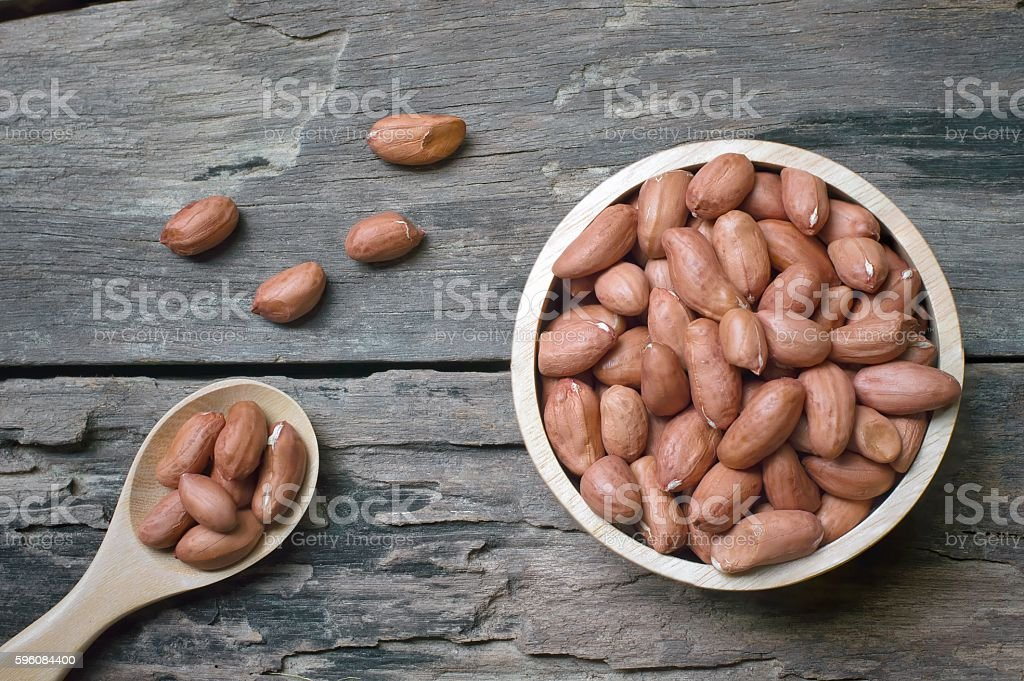 Peanuts on wooden background royalty-free stock photo