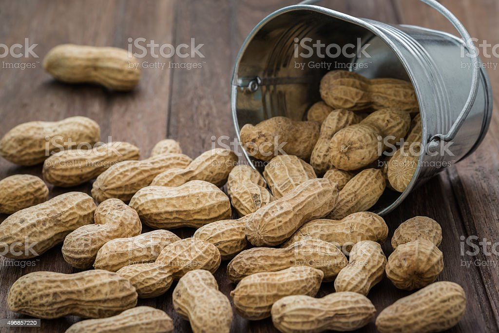 Peanuts on wooden table stock photo