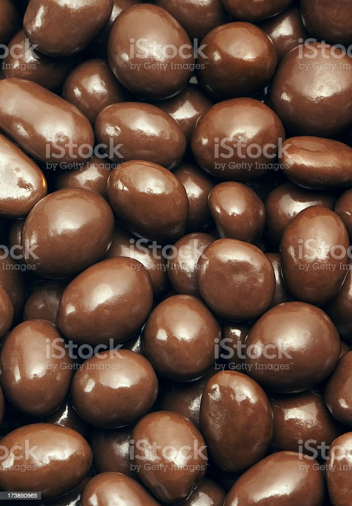 Peanuts or almonds covered with chocolate stock photo