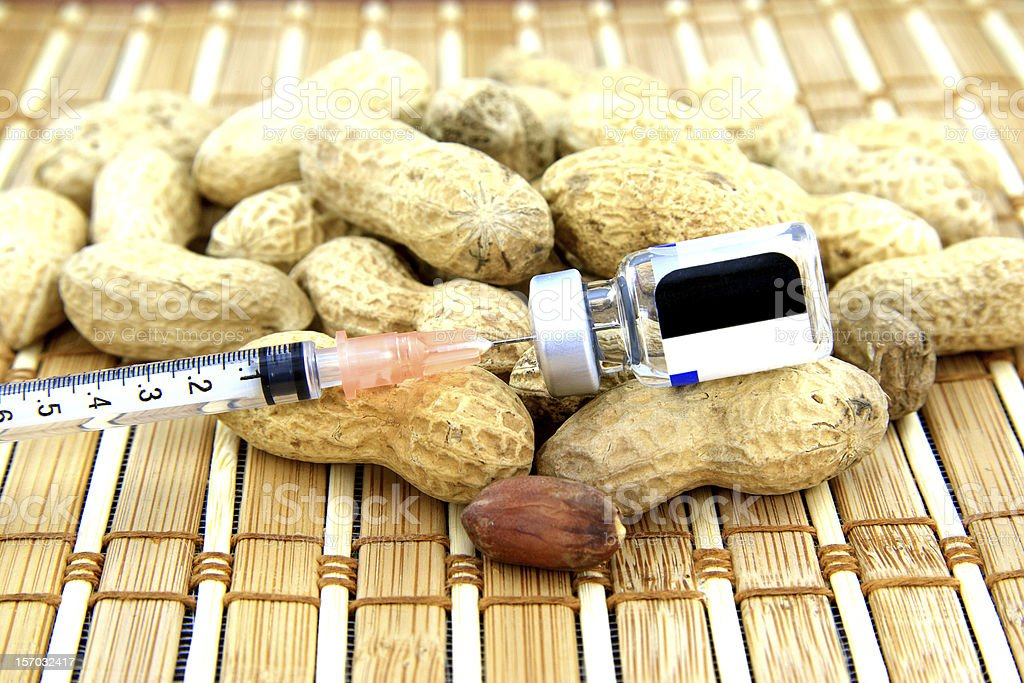 Peanuts with a syringe and medication stock photo